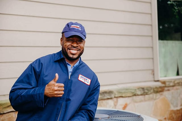 Smiling thumbs-up TemperaturePro technician