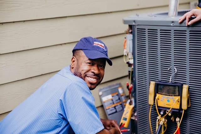 smiling, friendly HVAC technician