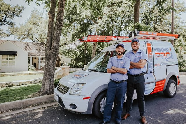 Temperature pro team standing in front of their company van